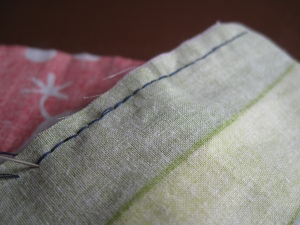 The smooth neat side of the backstitch seam