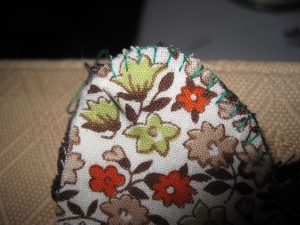 Binding the edges with blanket stitch. Decorative and practical.