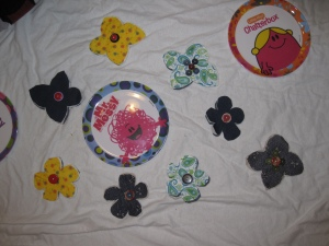 Flower brooches waiting to be stitched together.