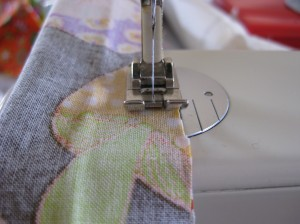 Sew the edge using a straight stitch. You could do this by hand but for this project the machine really is better.